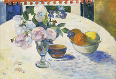 Flowers and a Bowl of Fruit on a Table