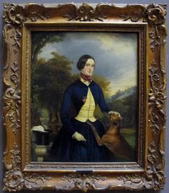 Portrait de femme en amazone avec son chien