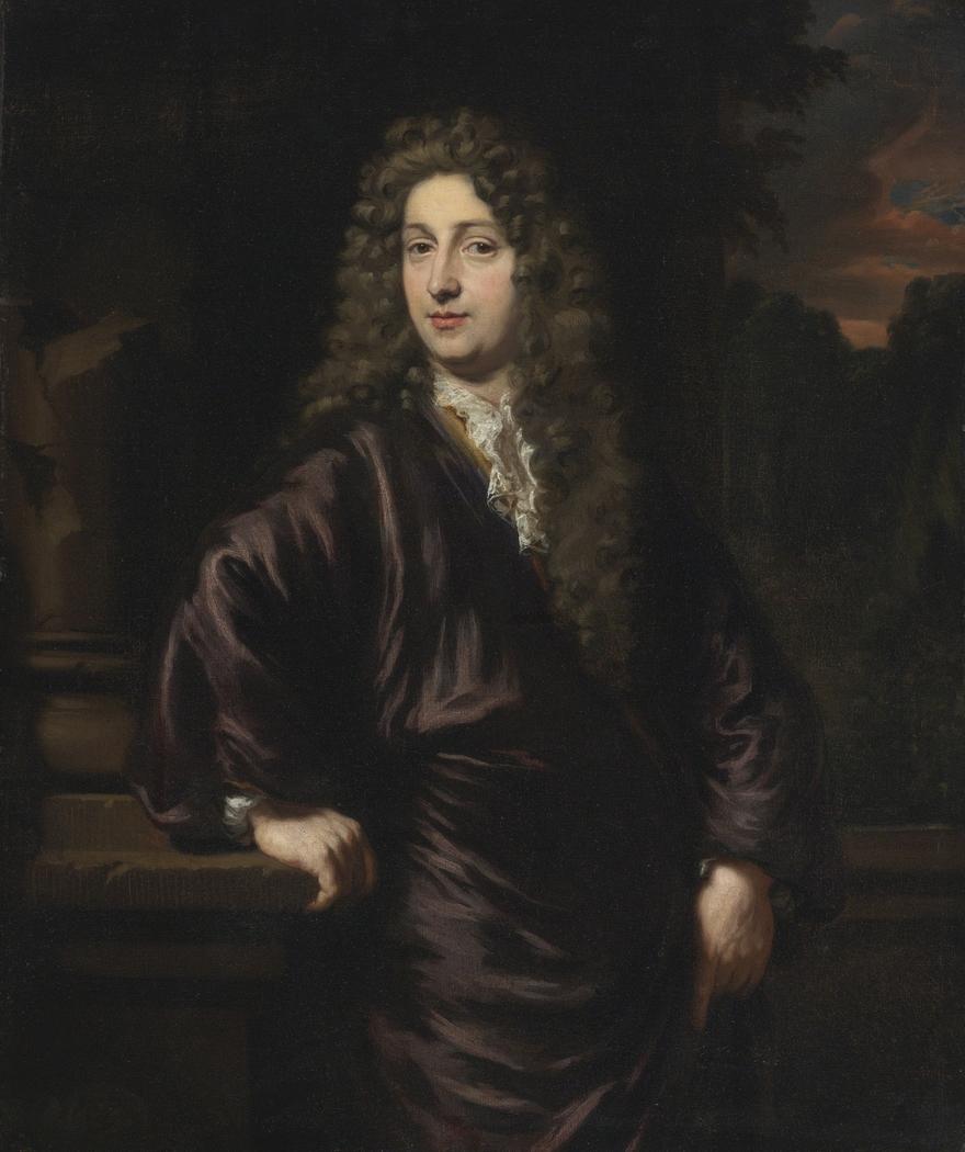 Portrait of a man holding a plinth