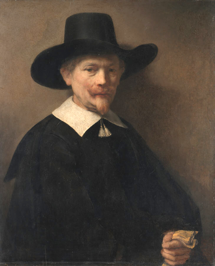 Portrait of a Man Holding Gloves