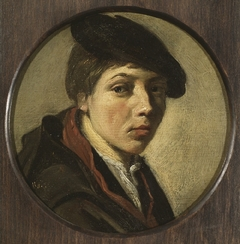 Round portrait of a boy with beret