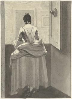 Vrouw staande voor een deur