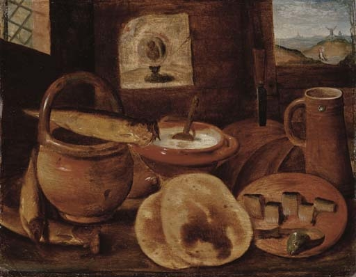 A poor man's meal, a loaf of bread, porridge, buns and a herring on a wooden table