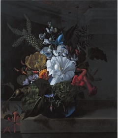 A Still Life with Devil's Trumpet, a Cactus, a Fig Branch, Honeysuckle and Other Flowers in a Blue Glass Vase