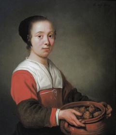 A Woman holding Oliebol Treats