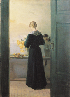 A young woman arranging flowers