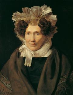 Alte Frau mit weißer Bänderhaube