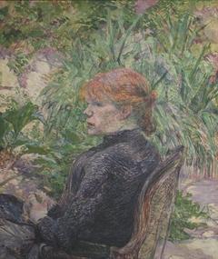 Femme rousse assise dans le jardin de M. Forest