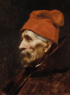Old man wearing a red fez