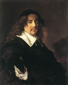 Portrait of a man with long hair and a mustache