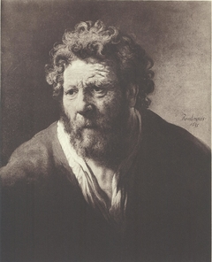 Portrait of an old man with disheveled hair