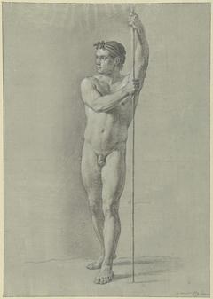 Staand mannelijk naakt met een stok