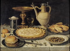 Still life with tazza, stoneware jug, saltcellar and dainties