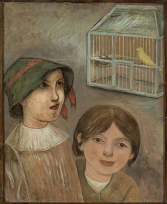 Two little girls beside a cage with a canary