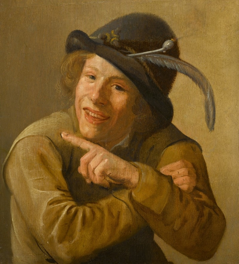 A Smiling Youth Wearing a Black Hat with a Feather and a Clay Pipe in the Brim