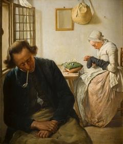 Interieur met een slapende man en een vrouw die sokken stopt