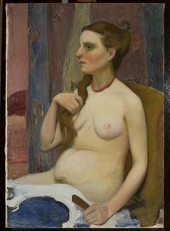 Nude of a woman combing her hair