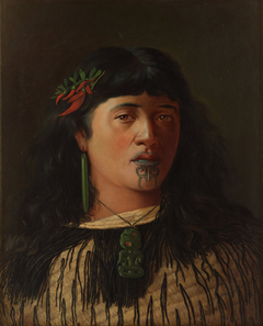 Portrait of a young Maori woman with moko