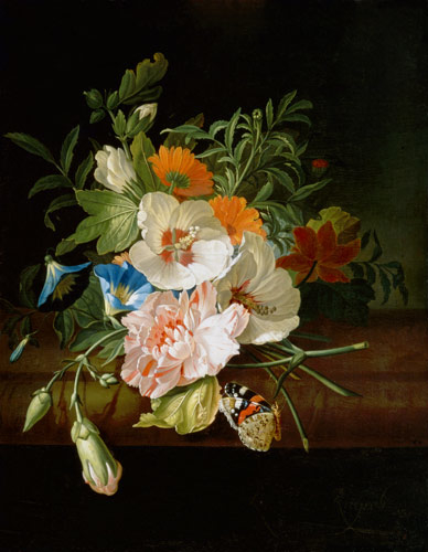 Posy of flowers, with a red admiral butterfly, on a marble ledge