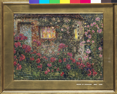 Country house among roses