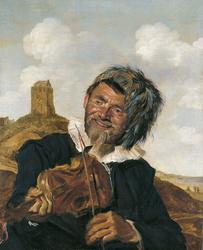 Left-handed violin player in a dune landscape