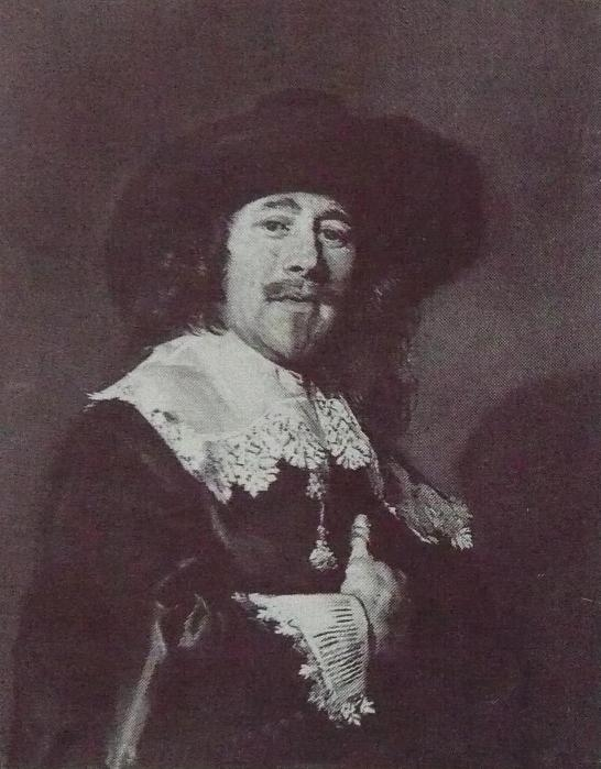 Portrait of a man with his hand on his chest