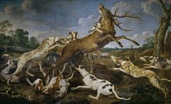 Ciervo acosado por una jauría de perros