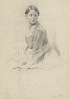 Zittende jonge vrouw