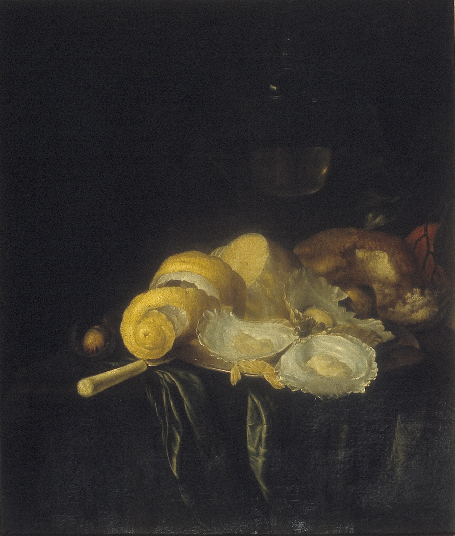 Still life with oysters and peeled lemon.