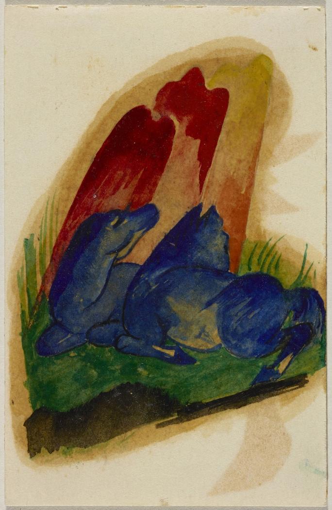 Zwei blaue Pferde vor rotem Felsen