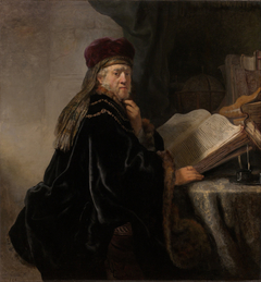 A Scholar, Seated at a Table with Books