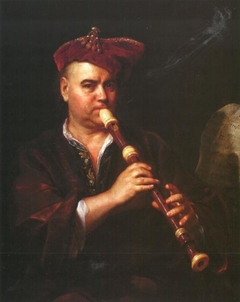 Man Playing on the Flute