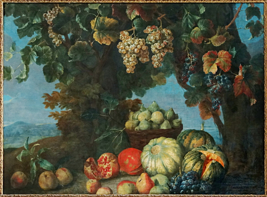 Nature morte de fruits et de raisins dans un paysage