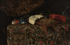 Still life with masks, books and musical instruments