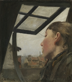 Young girl looking out of a roof window