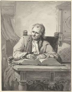 Zittende man aan een tafel met een opengeslagen bijbel