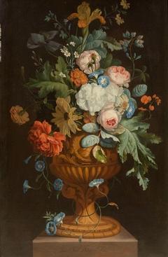 Flowers in a terracotta vase on a pedestal