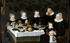 Gezin in gebed voor de maaltijd