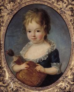 Portrait d'une petite fille tenant une poupée
