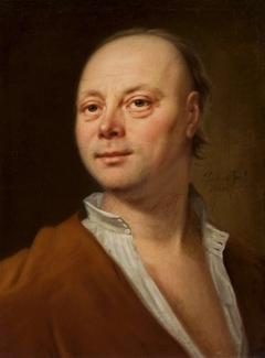 Portrait of a man in yellow coat.