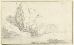 Rotsachtige kust met schepen in de nabijheid