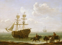 A beached collier unloading into carts