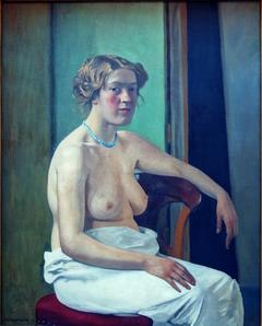 Femme assise à demi-nue