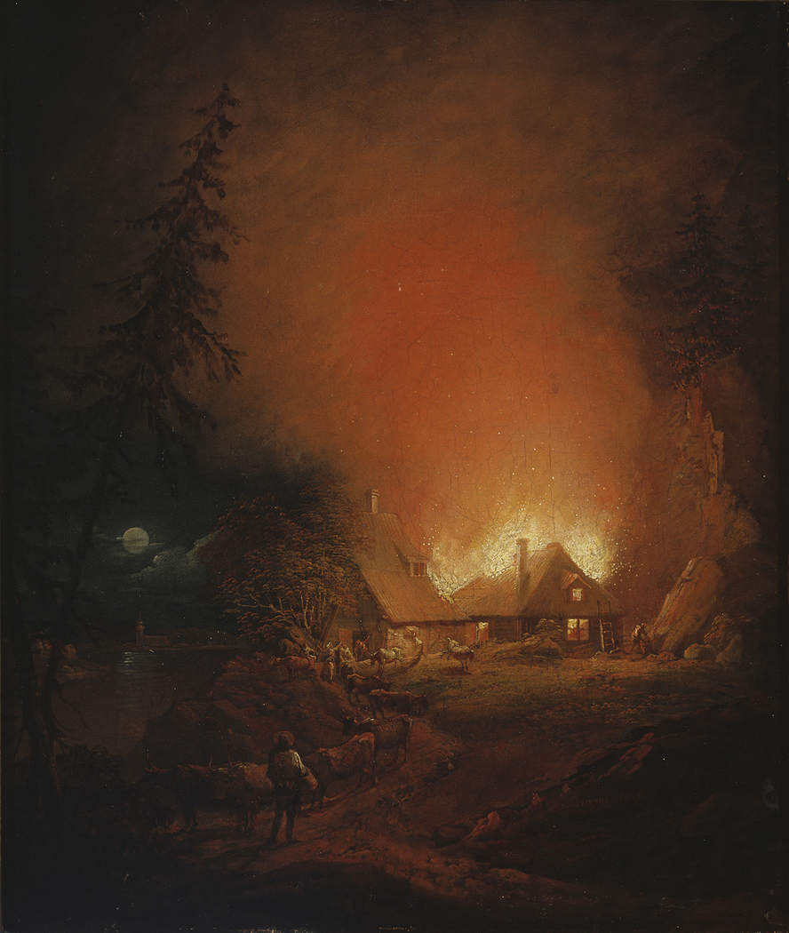 Fire at night in a farmhouse