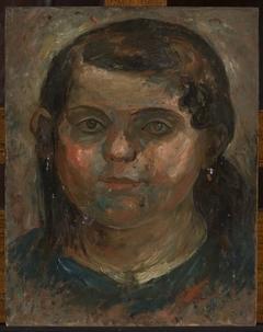 Head of a little girl in a blue dress