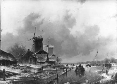 Houtzaagmolens aan een vaart bij winter