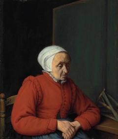 Portrait of an elderly lady in a red coat