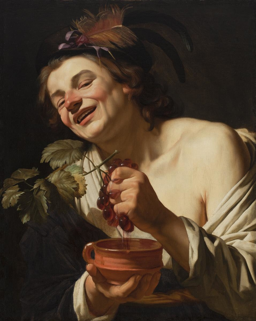 Smiling Young Man Squeezing Grapes