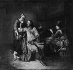 Two soldiers with a serving woman and a boy in a tavern