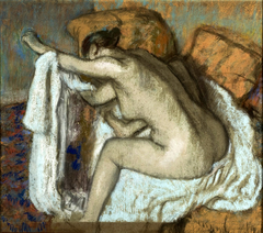 Woman drying her left arm